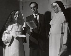 Robert Gard with nuns at a 1957 conference, #S10376
