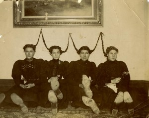 """An attempt at forming the """"W"""" with their hair? These UW students engage in creative fun, c. 1910. #S14873"""