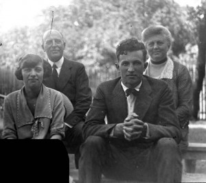 Thomas and Mary Brittingham sit for a portrait with their son Thomas Brittingham Jr. and his first wife, Mildred Candy. 1922. #WI.bls0079
