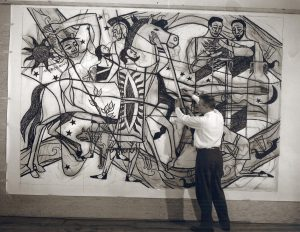 James Watrous works on a sketch featuring a horse and human figures