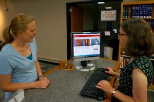 A patron being helped at the Reference Desk