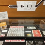 Display case with posters and cartoneras for the Ayotzinapa Exhibit.