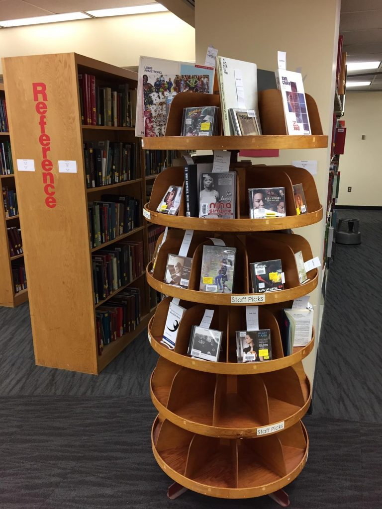 Mills Music Library Staff Picks tree, displaying books, scores, CDs, LPs, DVDs, and VHS tapes chosen by staff to be highlighted