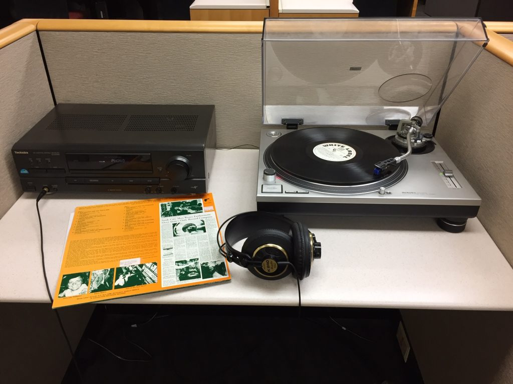 Turntable with LP playing through headphones in Mills Music Library