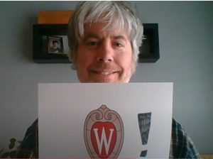 Music Technical Services Librarian Matt Appleby holds sign supporting UW-Madison students