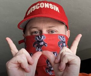 Ethnic American Music Curator Nate Gibson makes the W sign to support UW-Madison students