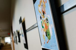 Color prints along Ebling Library Exhibit Wall