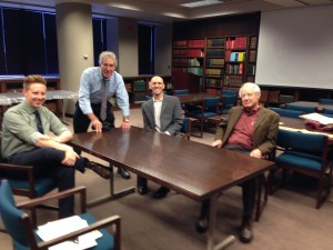 Skye Doney, Andrew Stangel, Eric O'Connor, and Adam Hochschild meet at the WWI exhibit in the Department of Special Collections.