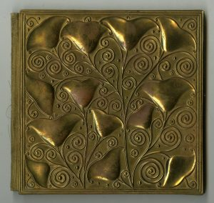 Bilder aus Karlsbad. Embossed metal brass book cover designed by Viennese workshop artist Carl Otto Czeschka.