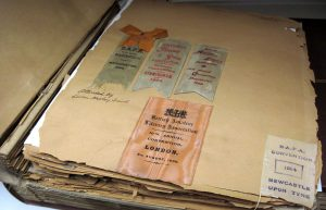 Scrapbook with convention memorabilia, from the Edwin Hadley Smith collection.