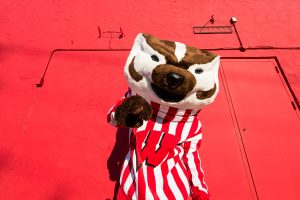 UW-Madison mascot Bucky Badger and early-morning shadows are pictured against a red-colored wall near the University of Wisconsin-Madison campus on May 30, 2014. (Photo by Jeff Miller/UW-Madison)